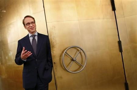 Germany's federal reserve Bundesbank President Jens Weidmann stands beside the door of a giant safe as he poses for a photograph at the money museum next to the Bundesbank headquarters during a photo shoot with Reuters in Frankfurt May 17, 2013. REUTERS/Kai Pfaffenbach