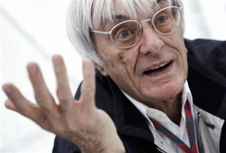 Formula One commercial supremo Bernie Ecclestone gestures as he is interviewed prior to the German F1 Grand Prix at the Nuerburgring circuit July 23, 2011. REUTERS/Alex Domanski