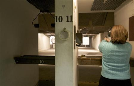 A woman at a shooting range in Connecticut April 2, 2013. REUTERS/ Michelle McLoughlin