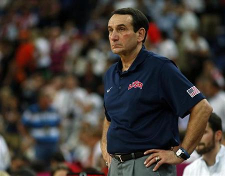The U.S. head coach Mike Krzyzewski watches his team against Spain during their men's gold medal basketball match at the North Greenwich Arena in London during the London 2012 Olympic Games August 12, 2012. REUTERS/Mike Segar