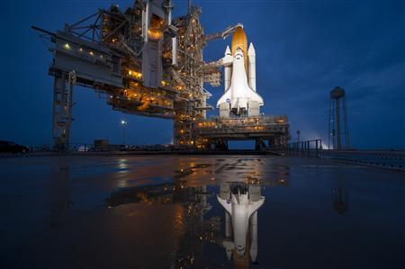 The space shuttle Atlantis is seen shortly after the rotating service structure (RSS) was rolled back at launch pad 39A at the NASA Kennedy Space Center in Cape Canaveral, Florida in this picture taken July 7, 2011. REUTERS/Bill Ingalls-NASA/Handout