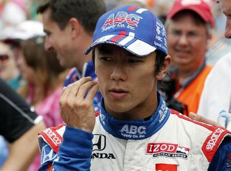 A.J. Foyt Enterprises driver Takuma Sato of Japan walks down pit lane after qualifying for the Indianapolis 500 at the Indianapolis Motor Speedway in Indianapolis, Indiana, May 18, 2013. REUTERS/John Sommers II