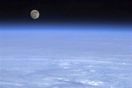 The moon is pictured above Earth in this handout photo courtesy of Col. Chris Hadfield of the Canadian Space Agency. REUTERS/CSA/Col. Chris Hadfield/Handout