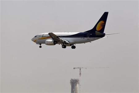 A Jet Airways passenger plane prepares to land as a new air traffic control tower under construction is seen in the background at the Indira Gandhi International Airport in New Delhi May 24, 2013. REUTERS/Anindito Mukherjee