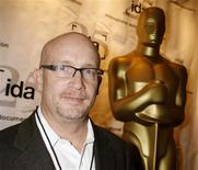 Director Alex Gibney poses at the International Documentary Association's annual celebration of the Academy Awards Documentary nominees in Beverly Hills, California in this February 20, 2008 file photo. WikiLeaks founder Julian Assange may claim to be a champion of transparency, but when an Oscar-winning filmmaker Gibney wanted to shine a light on his rise to fame after publishing secret U.S. diplomatic cables on his website, Assange was none too pleased. REUTERS/Fred Prouser/Files