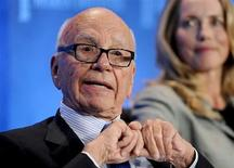 """Chairman and CEO of News Corporation Rupert Murdoch talks next to Laurene Powell Jobs (R), founder of Emerson Collective and widow of the late Apple founder Steve Jobs, as they take part in a panel discussion titled """"Immigration Strategy for the Borderless Economy"""" at the Milken Institute Global Conference in Beverly Hills, California April 29, 2013. REUTERS/Gus Ruelas"""