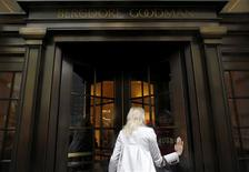 A woman enters high-end retail store Bergdorf Goodman along 5th Avenue in New York May 19, 2013. REUTERS/Eric Thayer