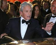 "Cast members Michael Douglas leaves after the screening of the film ""Behind the Candelabra"" in competition during the 66th Cannes Film Festival in Cannes May 21, 2013. REUTERS/Yves Herman"