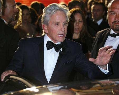 Cast members Michael Douglas leaves after the screening of the film ''Behind the Candelabra'' in competition during the 66th Cannes Film Festival in Cannes May 21, 2013. REUTERS/Yves Herman