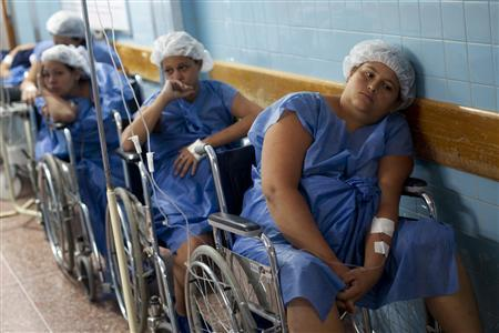 Pregnant women wait for their turn to undergo a Cesarean section (c-section) procedure at the Santa Ana public maternity hospital in Caracas October 19, 2011. REUTERS/Carlos Garcia Rawlins