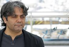 """Iranian director Mohammad Rasoulof poses during a photocall for the film """"Dast-Neveshtehaa Nemisoosand"""" (Manuscripts Don't Burn) at the 66th Cannes Film Festival in Cannes May 24, 2013. REUTERS/Regis Duvignau"""