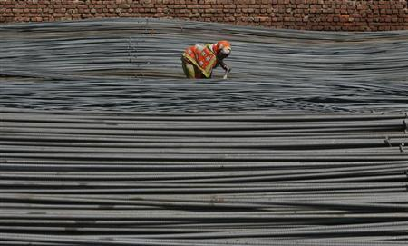 A labourer works inside an iron factory on the outskirts of Jammu October 1, 2012. REUTERS/Mukesh Gupta/Files