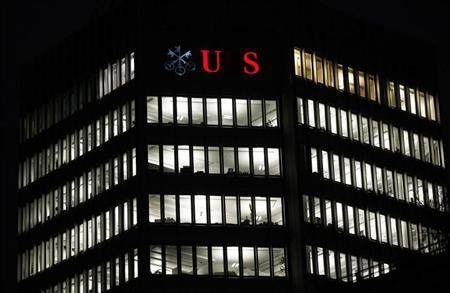 A partially illuminated logo of Swiss bank UBS is seen on a building in Zurich December 18, 2012. REUTERS/Michael Buholzer