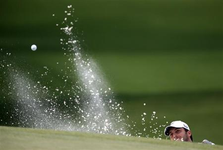 Francesco Molinari of Italy hits from a sand trap in the seventh hole during first round play in the 2013 Masters golf tournament at the Augusta National Golf Club in Augusta, Georgia, April 11, 2013. REUTERS/Phil Noble