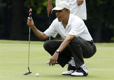 U.S. President Barack Obama lines up a putt on the first green at Andrews Air Force Base in Maryland, June 18, 2011. REUTERS/Larry Downing