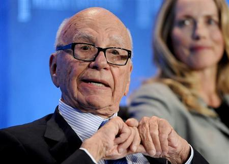 Chairman and CEO of News Corporation Rupert Murdoch talks next to Laurene Powell Jobs (R), founder of Emerson Collective and widow of the late Apple founder Steve Jobs, as they take part in a panel discussion titled ''Immigration Strategy for the Borderless Economy'' at the Milken Institute Global Conference in Beverly Hills, California April 29, 2013. REUTERS/Gus Ruelas
