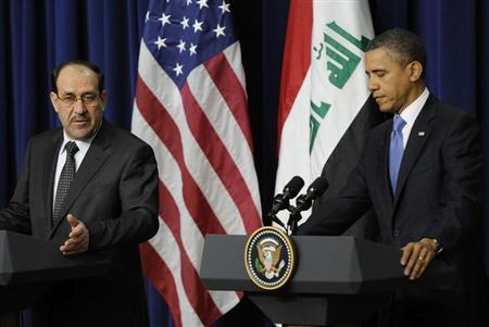 Iraq's Prime Minister Nuri al-Maliki (L) and U.S. President Barack Obama (R) hold a joint news conference in the Eisenhower Executive Office Building on the White House campus in Washington, December 12, 2011. REUTERS Jonathan Ernst