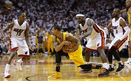 Indiana Pacers' George Hill (2nd L) grabs the ball after he was fouled by Miami Heat's LeBron James (2nd R) as Miami's Mario Chalmers (L) and Dwyane Wade look on during Game 2 of their NBA Eastern Conference final basketball playoff in Miami, Florida May 24, 2013. REUTERS/Joe Skipper