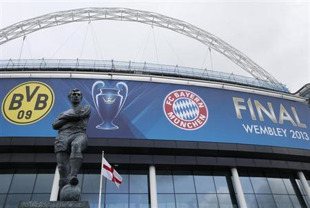 A statue of former England player Bobby Moore stands outside Wembley Stadium before the training sessions of Bayern Munich and Borussia Dortmund ahead of their Champions League Final soccer match in London, May 24, 2013. REUTERS/Eddie Keogh (BRITAIN)