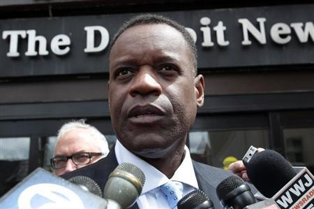 Detroit's emergency financial manager Kevyn Orr talks to members of the media outside the Detroit Newspapers building about the report he delivered to the State of Michigan about Detroit's finances, in Detroit, Michigan May 13, 2013. REUTERS/Rebecca Cook