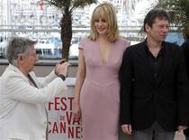 "Director Roman Polanski (L) takes pictures as cast members Emmanuelle Seigner (C) and Mathieu Amalric (R) pose during a photocall for the film ""La Venus a la Fourrure"" (Venus in Fur) at the 66th Cannes Film Festival in Cannes May 25, 2013. REUTERS/Regis Duvignau"