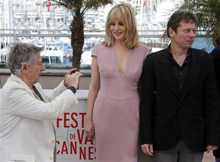 Director Roman Polanski (L) takes pictures as cast members Emmanuelle Seigner (C) and Mathieu Amalric (R) pose during a photocall for the film ''La Venus a la Fourrure'' (Venus in Fur) at the 66th Cannes Film Festival in Cannes May 25, 2013. REUTERS/Regis Duvignau