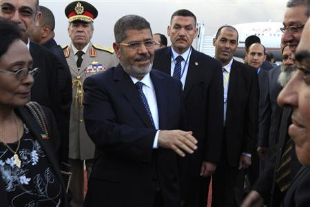 Egypt's President Mohamed Mursi (C) arrives at Bole International airport for the 21st Ordinary Session of the African Union (AU) in Addis Ababa May 24, 2013. REUTERS/Tiksa Negeri