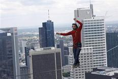 Professional slackliner Reinhard Kleindl walks a high wire in front of the Frankfurt skyline May 25, 2013. REUTERS/Ralph Orlowski
