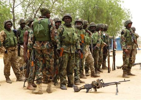 Soldiers stand during a parade in Baga village on the outskirts of Maiduguri, in the north-eastern state of Borno May 13, 2013. REUTERS/Tim Cocks