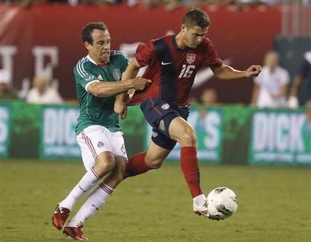 U.S. midfielder Robbie Rogers (16) is pulled down by Mexico defender Gerardo Torrado during the second half of their friendly soccer match in Philadelphia, Pennsylvania, August 10, 2011. REUTERS/Tim Shaffer