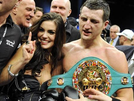 Britain's Carl ''The Cobra'' Froch holding the WBC super middleweights belt celebrates with wife Rachael Coardingly after defeating Germany's ''King'' Arthur Abraham in their WBC super middleweights title bout at boxing event of Super Six World Boxing Classic in Helsinki November 27, 2010. REUTERS/Jussi Nukari/Lehtikuva