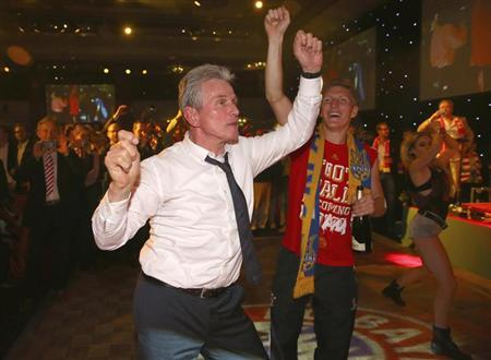 Bayern Munich coach Jupp Heynckes dances together with midfielder Bastian Schweinsteiger at the team's banquet at Grosvenor House in London May 26, 2013, following their Champions League victory after defeating Borussia Dortmund at Wembley stadium. REUTERS/Alexander Hassenstein/Pool