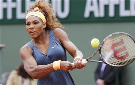 Serena Williams of the U.S. hits a return to Anna Tatishvili of Georgia during their women's singles match at the French Open tennis tournament at the Roland Garros stadium in Paris May 26, 2013. REUTERS/Philippe Wojazer
