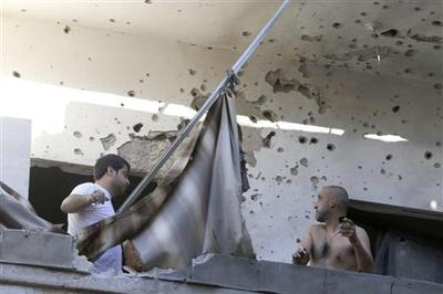 Rockets hit south Beirut after Hezbollah vows Syria...