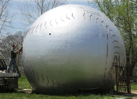 Keith Wilson does welding work on a water tower top being turned into a giant baseball in Muscotah, Kansas, April 30, 2013. REUTERS/Kevin Murphy