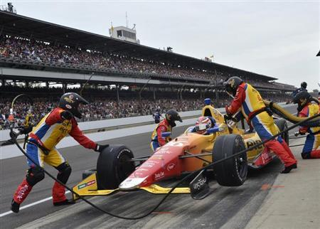 Andretti Autosport driver Carlos Munoz of Colombia stops in the pits during the 97th running of the Indianapolis 500 at the Indianapolis Motor Speedway in Indianapolis, Indiana, May 26, 2013. REUTERS/Geoff Miller