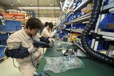 A worker assembles components at a workshop of Bernard Controls in Beijing April 25, 2013. REUTERS/Ed Jones/Pool