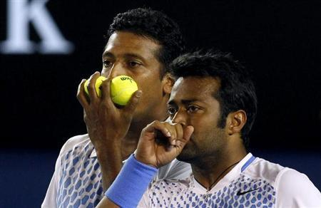 Mahesh Bhupathi and Leander Paes (R) of India react during their men's doubles final match against Bob Bryan and Mike Bryan of the U.S. at the Australian Open tennis tournament in Melbourne January 29, 2011. REUTERS/Daniel Munoz/Files