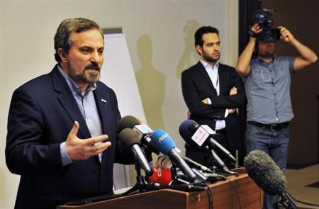 Louay al-Safi, spokesman for the Syrian National Coalition (L), speaks during a news conference in Istanbul May 26, 2013. REUTERS/Akin Celiktas