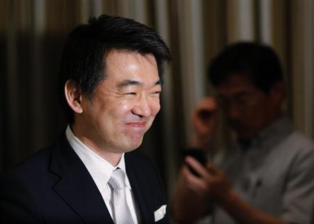 Osaka Mayor Toru Hashimoto leaves a news conference at the Foreign Correspondents' Club of Japan in Tokyo May 27, 2013. REUTERS/Yuya Shino