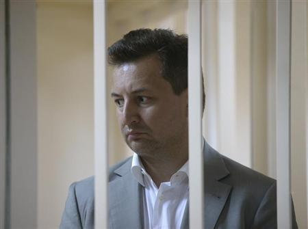 Vladimir Golubkov, the head of Societe Generale's Russian unit Rosbank, looks out from a holding cell during a court hearing in Moscow May 16, 2013. REUTERS/Maxim Shemetov