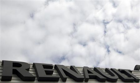 Clouds pass over the word Renault which is displayed on the front of a car dealership in Andernos, Southwestern France, February 13, 2013. REUTERS/Regis Duvignau