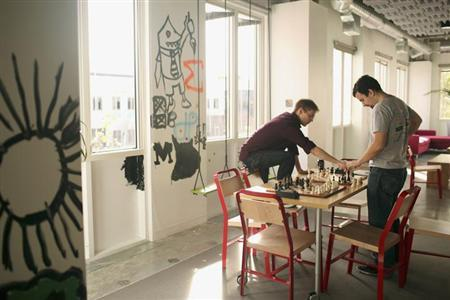 Employees play a game of chess at Facebook headquarters in Menlo Park, California January 29, 2013. REUTERS/Robert Galbraith/Files