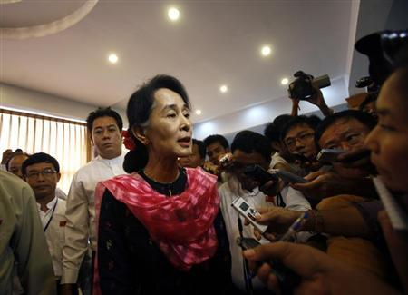 Myanmar pro-democracy leader Aung San Suu Kyi talks to reporters after giving a speech at the first meeting of the central executive committee of the National League for Democracy party in the Royal Rose hall in Yangon May 27, 2013. REUTERS/Soe Zeya Tun