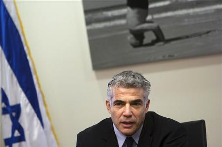 Israel's Finance Minister Yair Lapid attends a Yesh Atid party meeting at the Knesset, the Israeli parliament, in Jerusalem May 20, 2013. REUTERS/Ronen Zvulun
