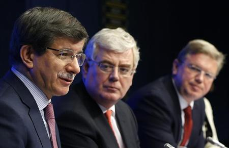 Turkey's Foreign Minister Ahmet Davutoglu (L-R) addresses a joint news conference with his Irish counterpart Eamon Gilmore and European Enlargement Commissioner Stefan Fule during an European Union-Turkey association council in Brussels May 27, 2013. REUTERS/Francois Lenoir