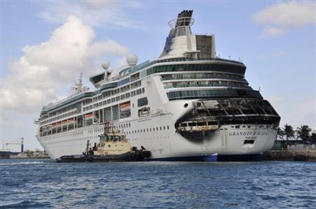 Damage on the Royal Caribbean ship Grandeur of the Seas is pictured as the ship is docked in Freeport May 27, 2013. REUTERS/Vandyke Hepburn