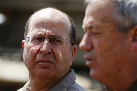 Israeli Defense Minister Moshe Yaalon (L) looks at Israel's armed forces chief Major-General Benny Gantz during a visit to a military base near Kibbutz Kissufim outside the central Gaza Strip May 7, 2013. REUTERS/Amir Cohen/Files