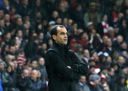 Wigan Athletic manager Roberto Martinez watches his side lose 4-1 to Arsenal in their English Premier League soccer match at the Emirates Stadium in London, May 14, 2013. REUTERS/Andrew Winning
