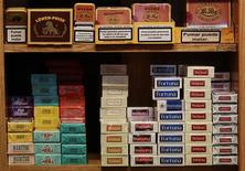 Packs of cigarettes are seen on a shelf at a tobacco store in central Madrid December 3, 2010. REUTERS/Andrea Comas